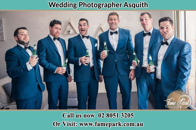 The groom and his groomsmen striking a wacky pose in front of the camera Asquith NSW 2077