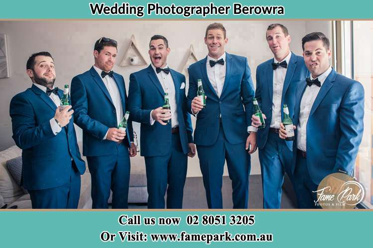 The groom and his groomsmen striking a wacky pose in front of the camera Berowra NSW 2081