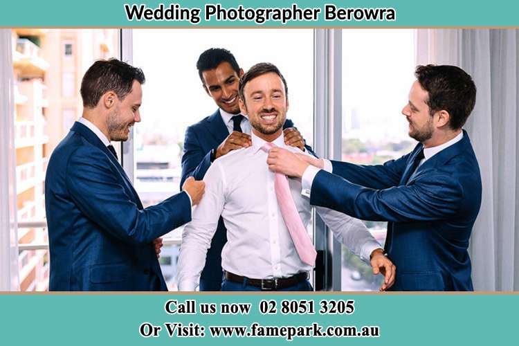 Photo of the Groom helping by the groomsmen getting ready Berowra NSW 2081