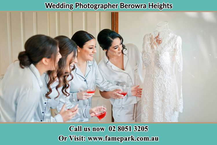 Photo of the Bride and the bridesmaids looking at the wedding gown Berowra Heights NSW 2082