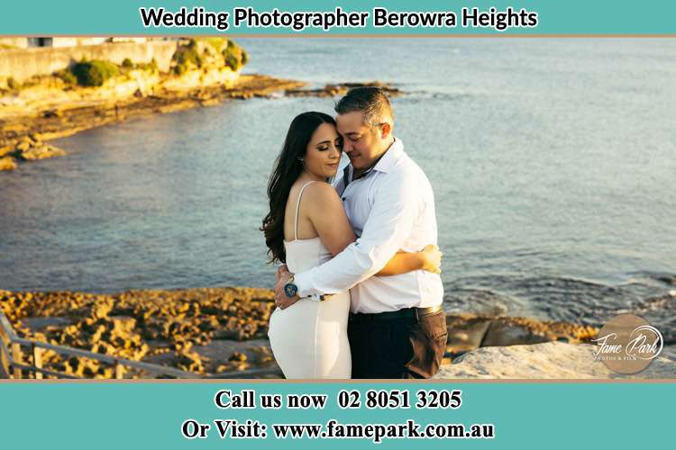 Photo of the Bride and the Groom hugging near the lake Berowra Heights NSW 2082