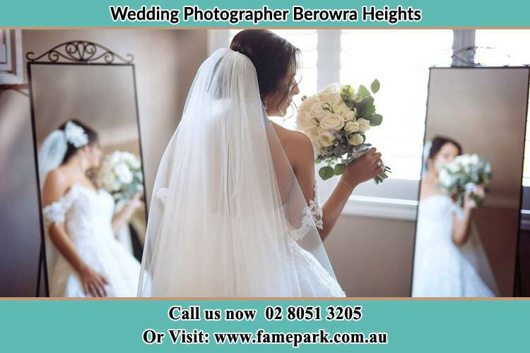 Photo of the Bride holding flower at the front of the mirrors Berowra Heights NSW 2082