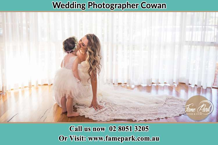 Photo of the Bride kiss the flower girl Cowan NSW 2081