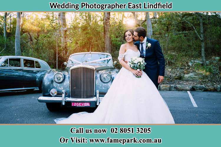 Photo of the Bride and the Groom at the front of the bridal car East Lindfield NSW 2070