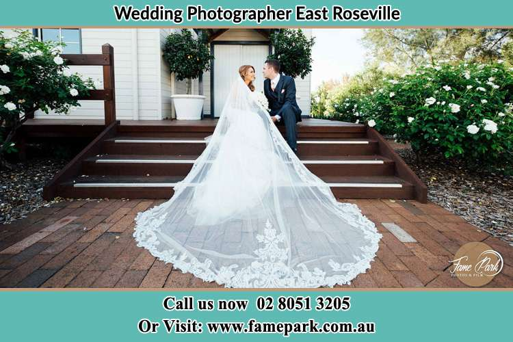 Photo of the Bride and the Groom looking each other while sitting at the staircase East Roseville NSW 2068