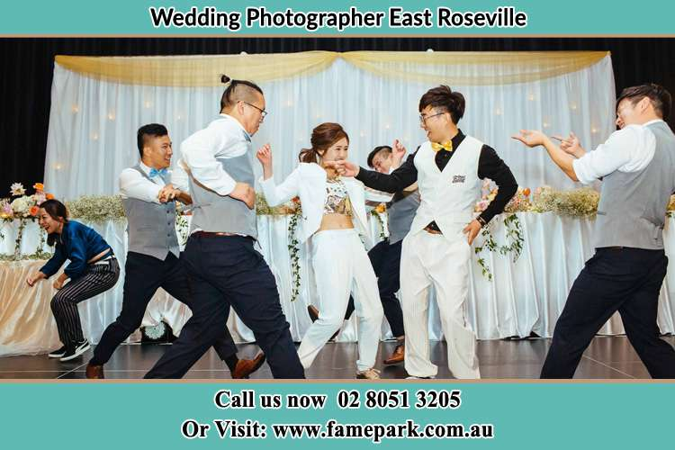 Photo of the Groom and the Bride dancing with the groomsmen at the dance floor East Roseville NSW 2068