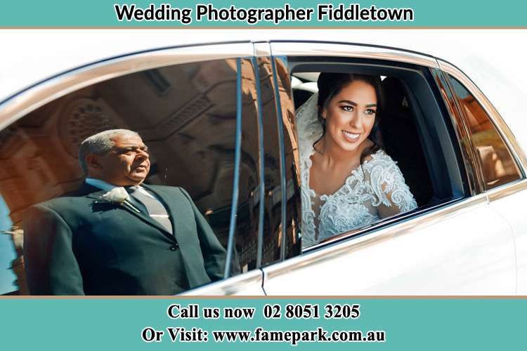 Photo of the Bride inside the bridal car with her father standing outside Fiddletown NSW 2159
