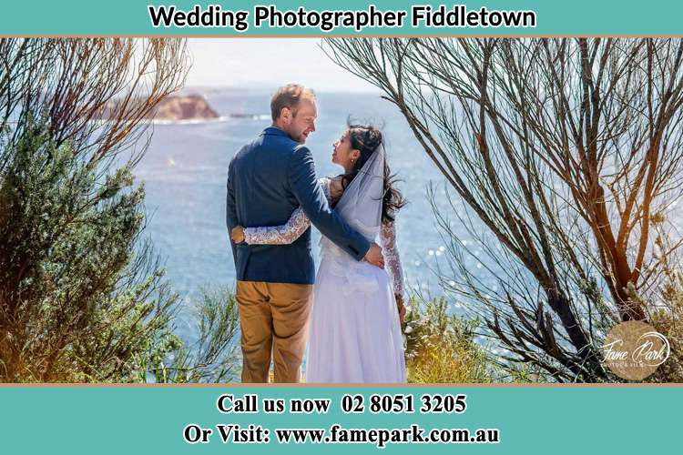 Photo of the Groom and the Bride looking each other near the sea front Fiddletown NSW 2159
