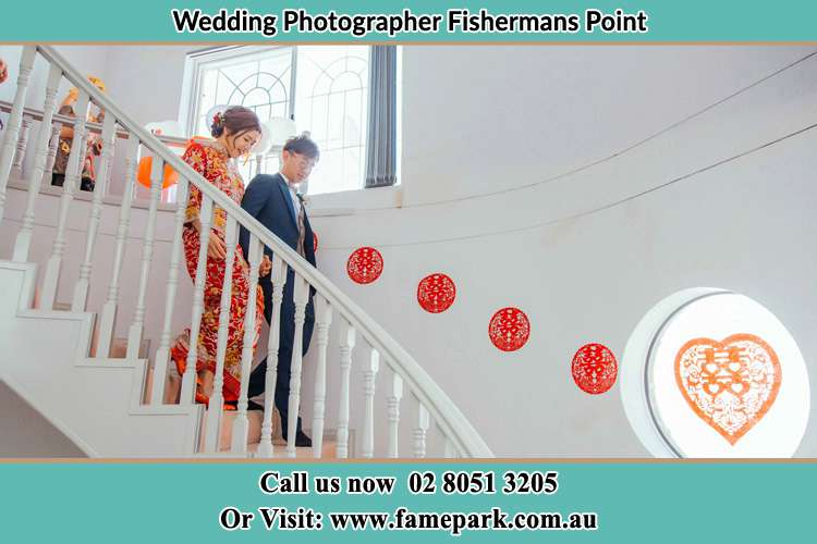 Photo of the Bride and the Groom going down the stair Fishermans Point NSW 2082