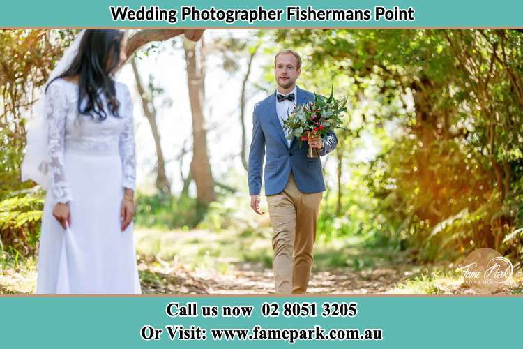 Photo of the Groom bringing flower to the Bride Fishermans Point NSW 2082