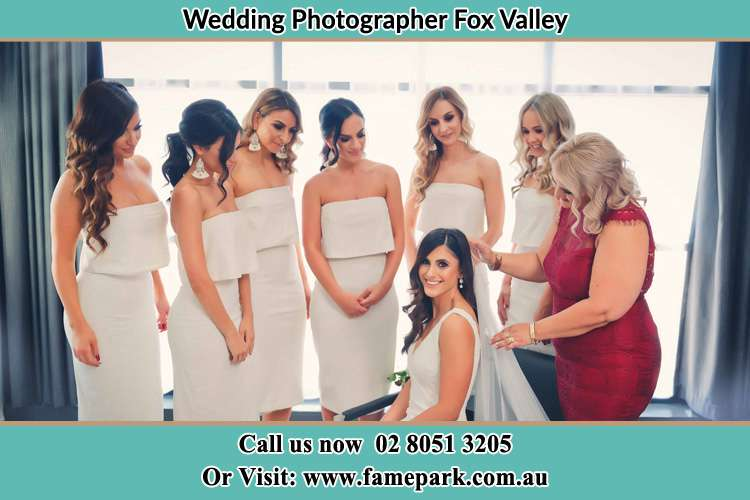 Photo of the Bride and the secondary sponsor preparing Fox Valley NSW 2076