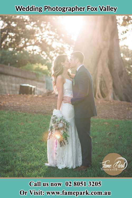 Photo of the Bride and the Groom kissing at the yard Fox Valley NSW 2076