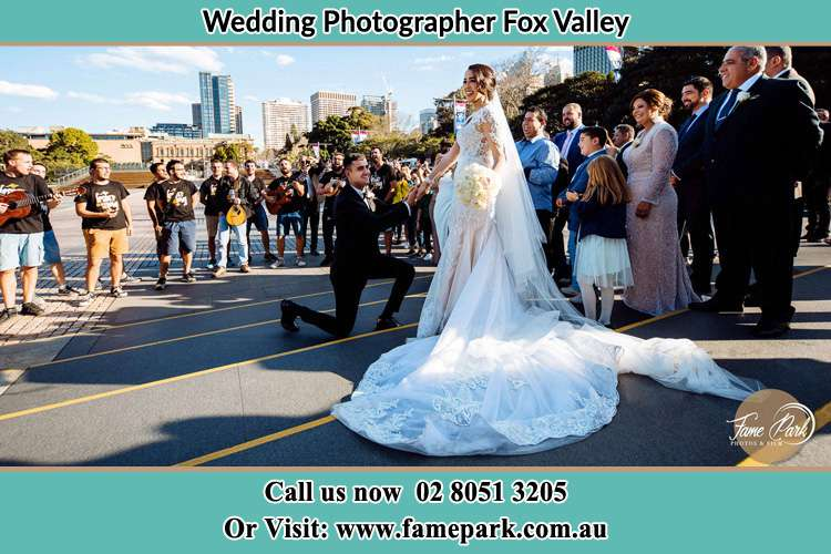 Groom Kneeling down in front of the Bride Fox Valley NSW 2076