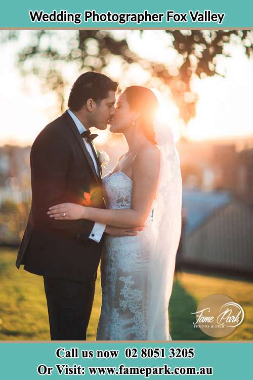 Photo of the Groom and the Bride kissing at the yard Fox Valley NSW 2076