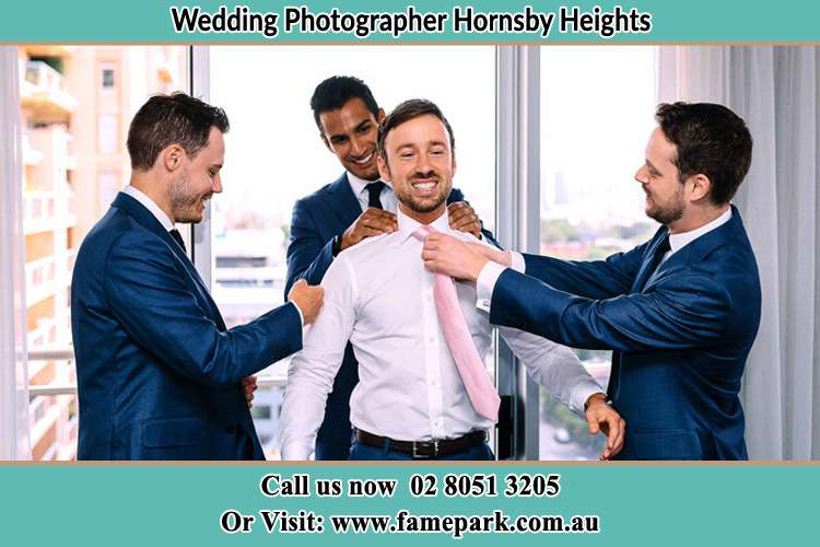 Photo of the Groom helping by the groomsmen getting ready Hornsby Heights NSW 2077