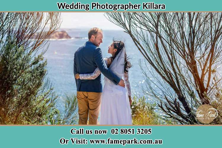 Photo of the Groom and the Bride looking each other near the sea front Killara NSW 2071