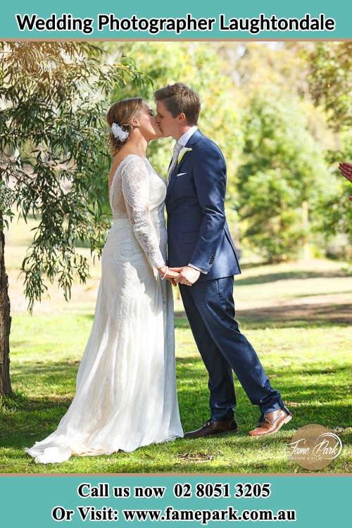 Photo of the Bride and the Groom kissing at the yard Laughtondale NSW 2775