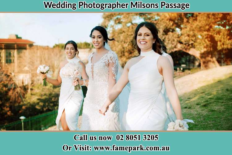 Photo of the Bride and the bridesmaids walking Milsons Passage NSW 2083