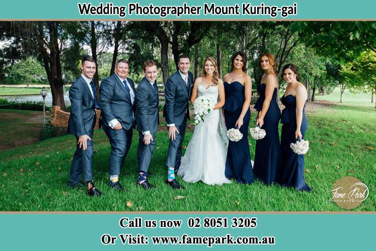 The Bride and the Groom with their entourage pose for the camera Mount Kuring-gai NSW 2080