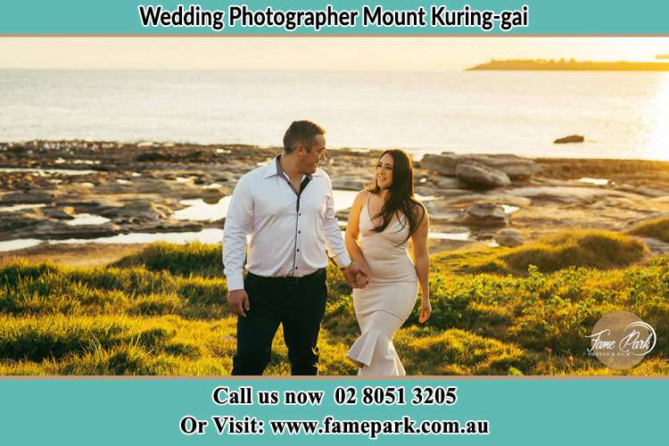 Photo of the Groom and the Bride walking near the lake Mount Kuring-gai NSW 2080