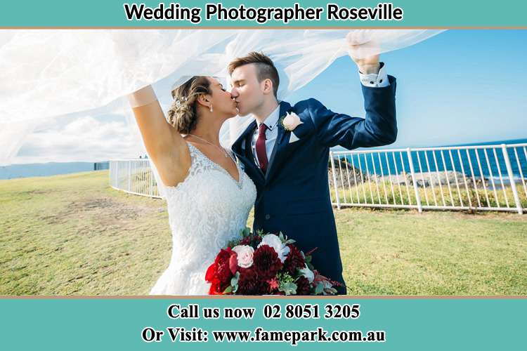 Photo of the Bride and the Groom kissing at the yard Roseville NSW 2069