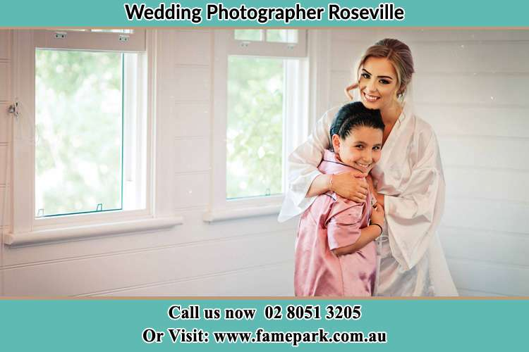 Photo of the Bride hugging the flower girl Roseville NSW 2069