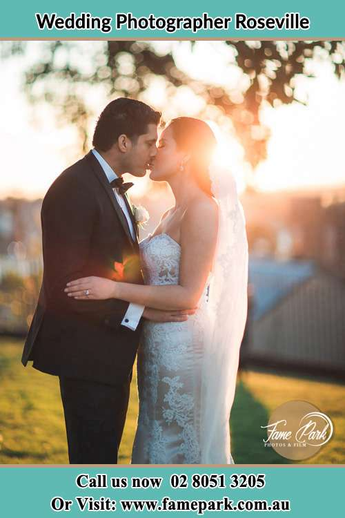 Photo of the Groom and the Bride kissing at the yard Roseville NSW 2069