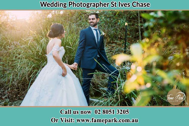 Photo of the Bride and the Groom going up the hill St Ives Chase NSW 2075