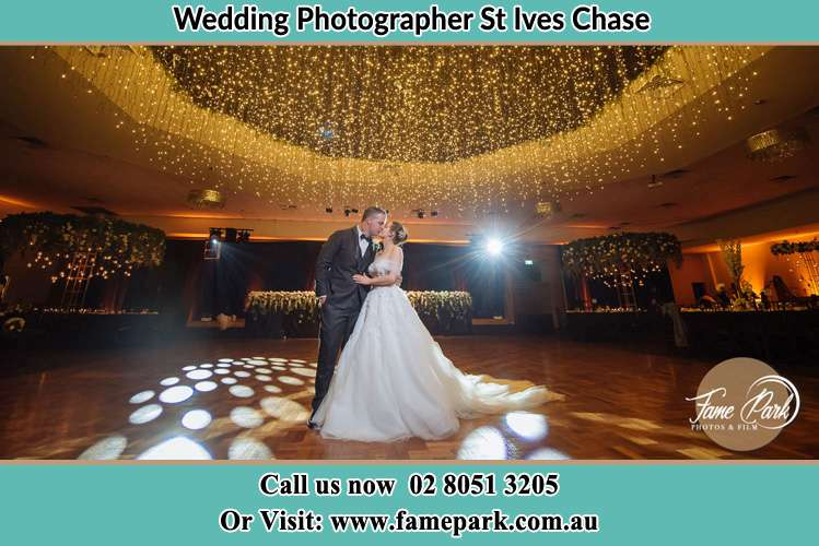 Photo of the Groom and the Bride kissing on the dance floor St Ives Chase NSW 2075
