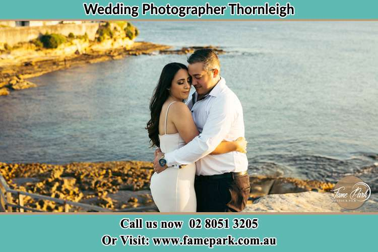 Photo of the Bride and the Groom hugging near the lake Thornleigh NSW 2120