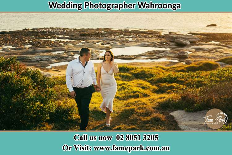 Photo of the Groom and the Bride walking near the lake Wahroonga NSW 2076