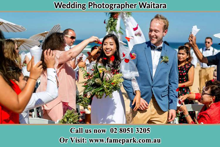 Photo of the Bride and the Groom showering flower petal by the visitors Waitara NSW 2077