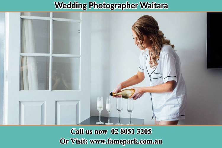 Photo of the Bride pouring wine on the glasses Waitara NSW 2077