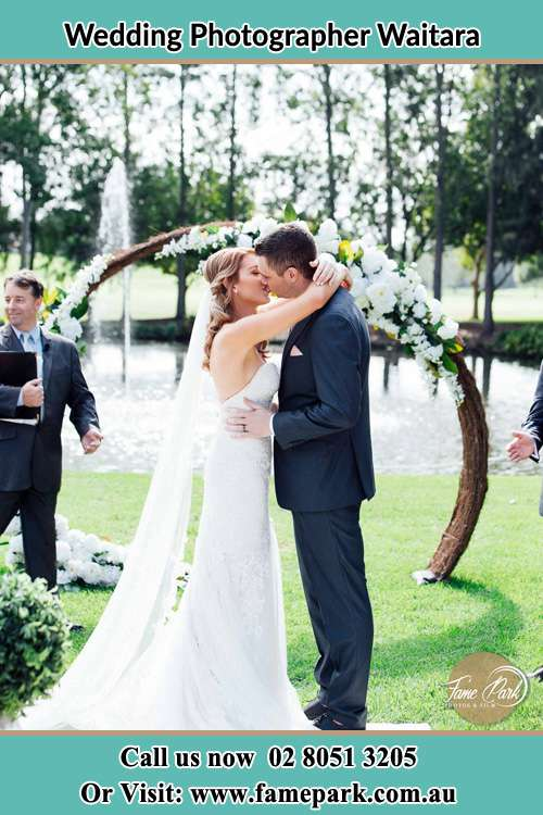 Photo of the Bride and the Groom kissing Waitara NSW 2077