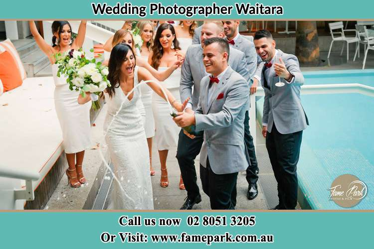 Photo of the Groom and the Bride celebrating with the secondary sponsors Waitara NSW 2077