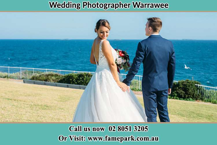 Photo of the Bride and the Groom holding hands at the yard Warrawee NSW 2074